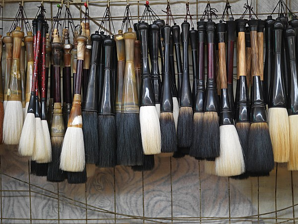 Calligraphy Brushes Hang On The Wall Print by Justin Guariglia