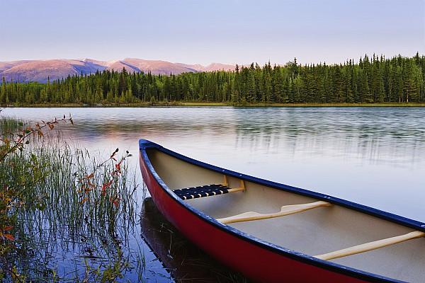 Canoe And Boya Lake At Sunset, Boya Print by Yves Marcoux