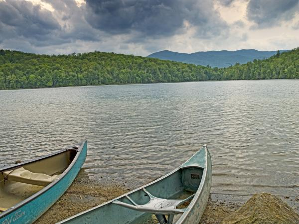 Canoes On Heart Lake Adirondack Park New York Print by Brendan Reals