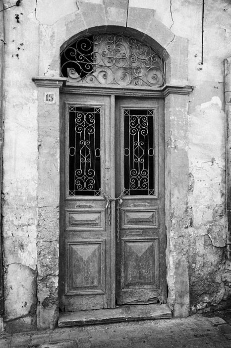 chained up wooden door to derelict house near the restricted area of the UN buffer zone Print by Joe Fox