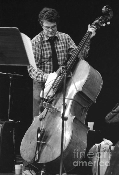 Charlie Haden Takes Care Of His Doublebass Photograph  - Charlie Haden Takes Care Of His Doublebass Fine Art Print