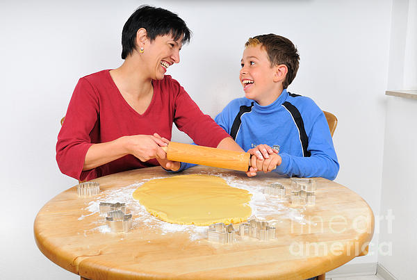 Christmas Baking - Mother And Son Laughing Print by Matthias Hauser