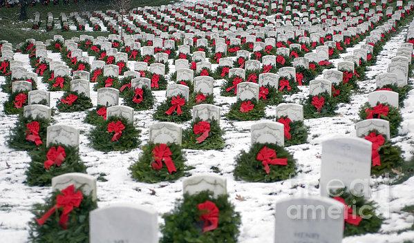 Christmas Wreaths Adorn Headstones Print by Stocktrek Images