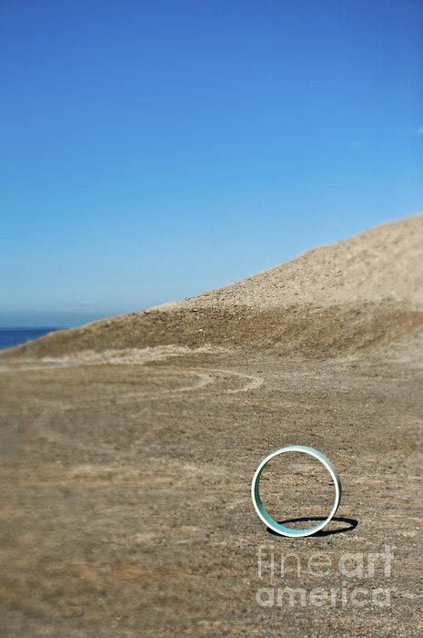 Circular Object On Beach Print by Eddy Joaquim