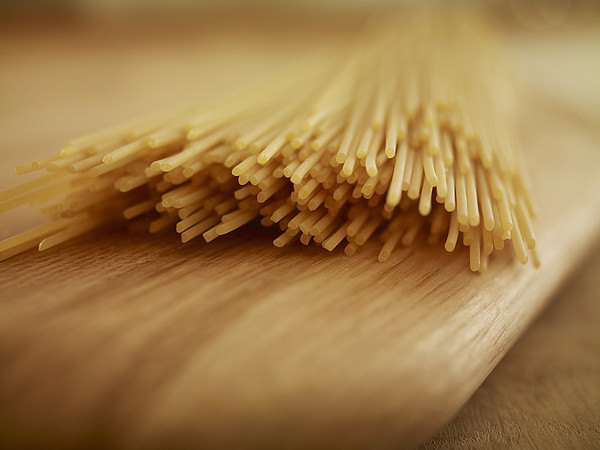 Adam Gault - Close Up Of Uncooked Spaghetti Noodles On Cutting Board