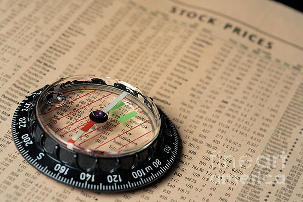 Compass On Stockmarket Cotation In Newspaper Print by Sami Sarkis