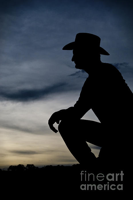Cowboy Silhouette At Sunset Print by Andre Babiak