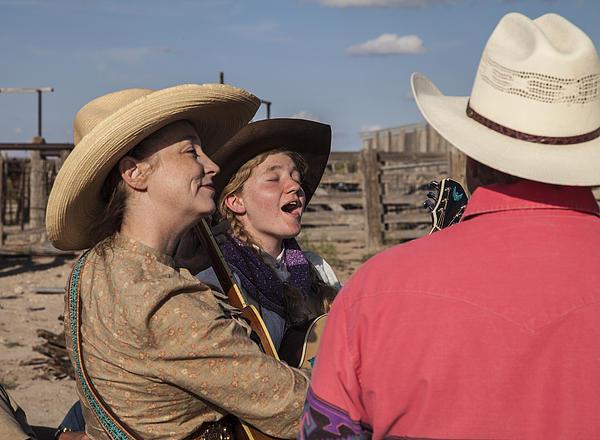 Cowgirl Serenading The Cowboys Print by Ralph Brannan