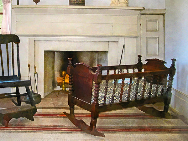 Cradle Near Fireplace Print by Susan Savad