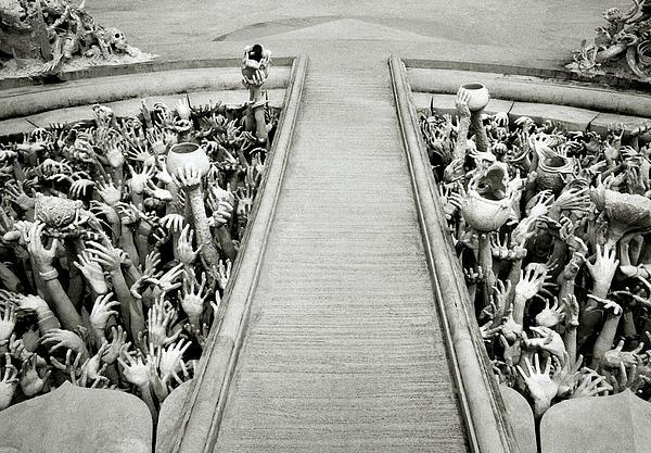 Cycle Of Rebirth At Wat Rong Khun In Thailand Print by Shaun Higson