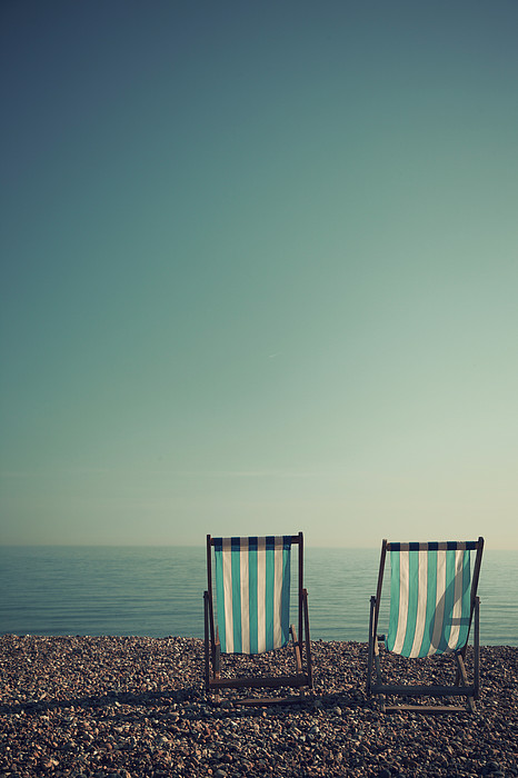 Deck Chairs On Brighton Beach Print by Paul Grand Image