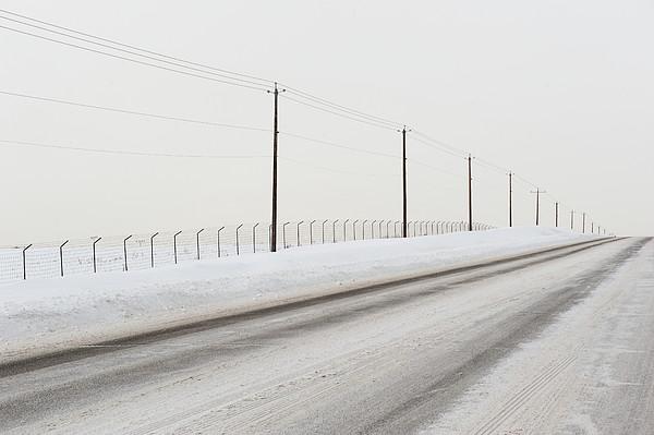 Desolate Winter Road Print by Lynn Koenig
