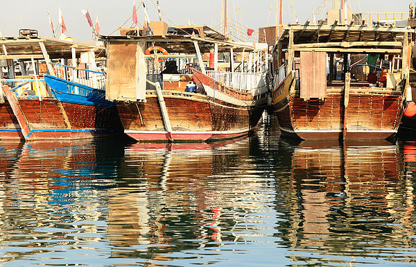 Dhow Reflections Print by Paul Cowan