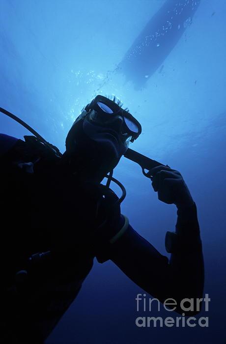 Diver Holding Gun To Head Underwater Print by Sami Sarkis