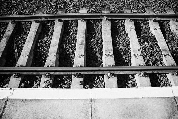 Edge Of Railway Station Platform And Track Northern Ireland Uk Print by Joe Fox