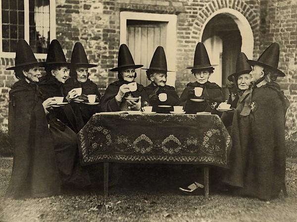 Eight Women In High Hats Having Tea Print by Everett