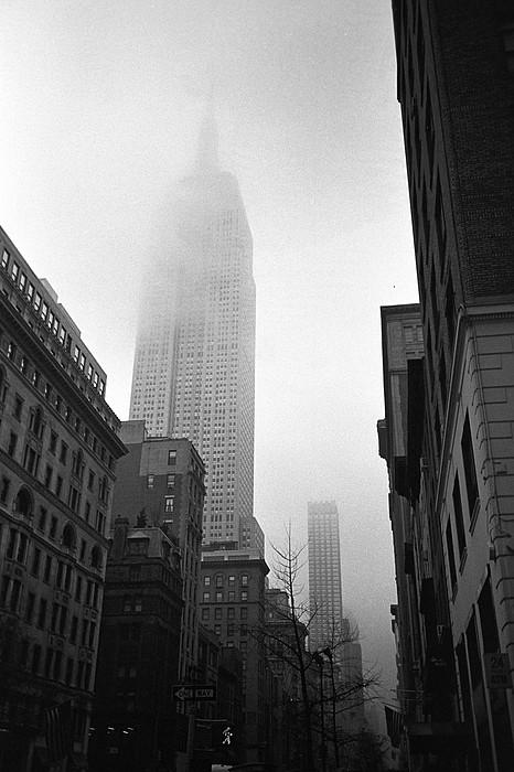 Empire State Building In Fog Print by Adam Garelick