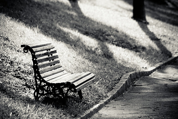 Empty Park Bench On Edge Print by (c) Conrado Tramontini