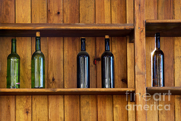 Five Bottles Print by Carlos Caetano