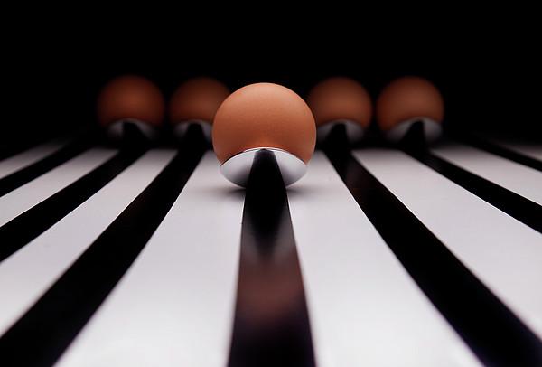 Five Brown Eggs Held In Five Stainless Steel Spoon Print by TonyMaj