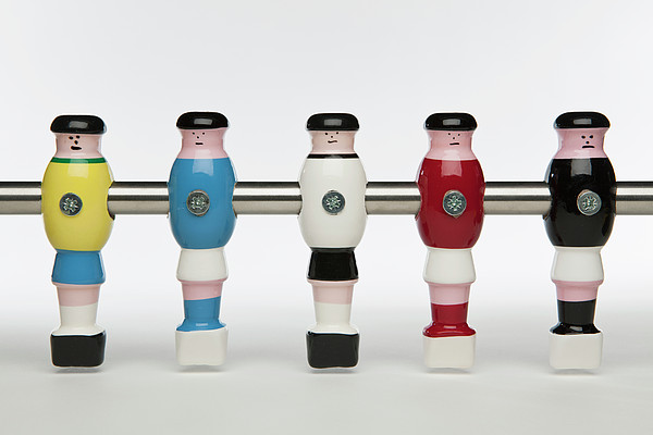 Five Foosball Figurines Wearing Different Uniforms Print by Caspar Benson