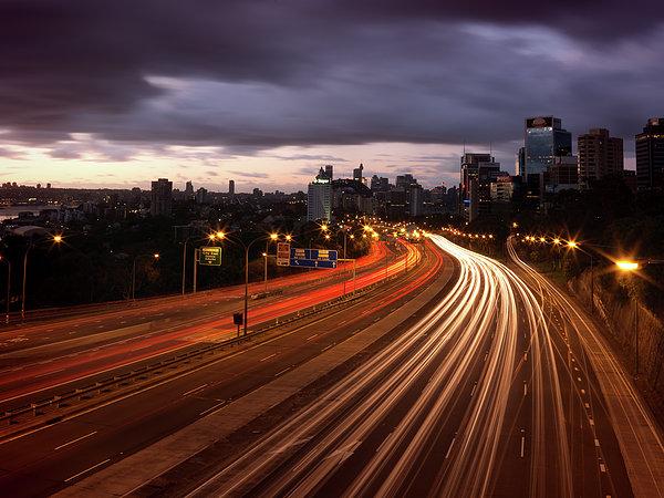 Freeway Lights At Dawn Print by John Clutterbuck