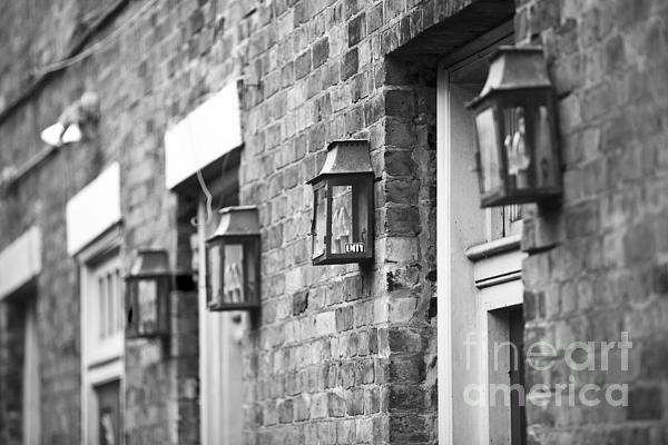 French Quarter Lamps Print by Leslie Leda