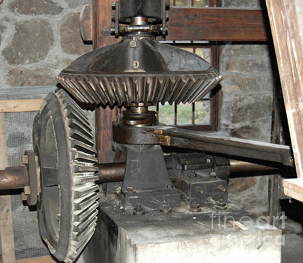 Gears Of The Old Grist Mill Print by John Small