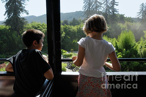 Girl And Boy Looking Out Of Train Window Print by Sami Sarkis