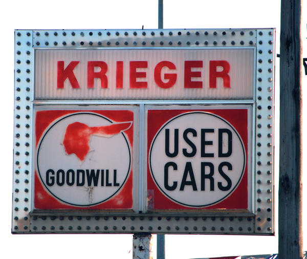 Goodwill Used Cars Print by Jame Hayes