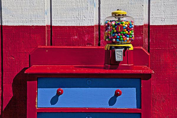 Gum Ball Machine On Red Desk Print by Garry Gay