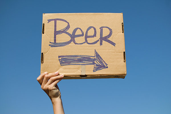 Hand Holding Up Makeshift 'beer' Sign Print by Pete Starman
