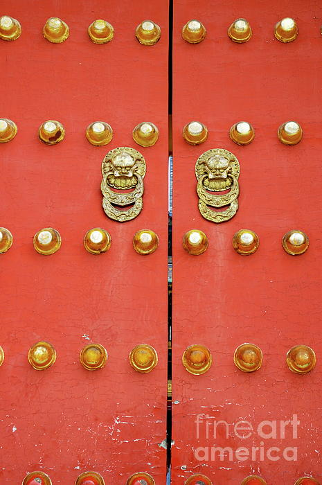 Heavy Ornate Door Knockers On A Gate Print by Sami Sarkis