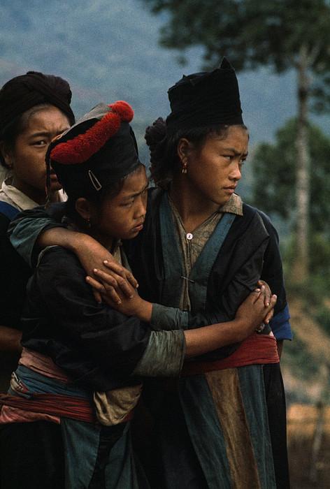 Hmong Girls Cling To Each Other Print by W.E. Garrett