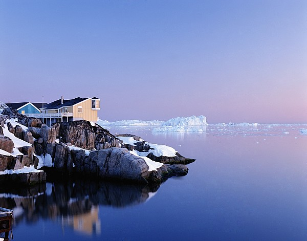 Houses On The Coastline With Icebergs Print by Axiom Photographic