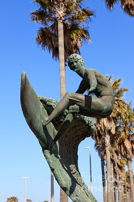 Huntington Beach Surfer Statue Print by Paul Velgos