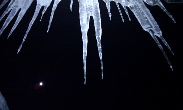 Icicle Moon Print by Aaron Warner