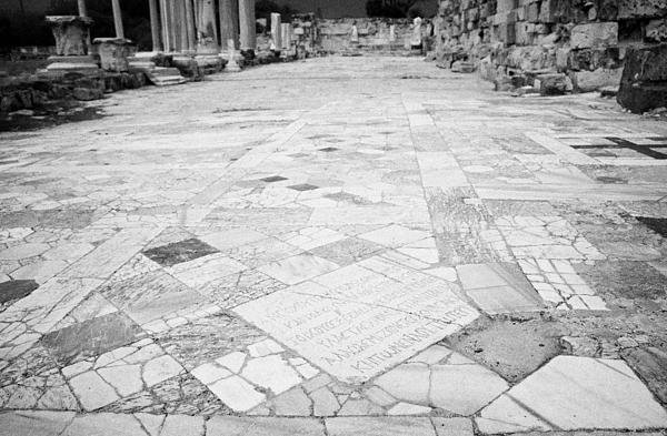 Inscription In The Floor Tile Of The Gymnasium Stoa Ancient Site Of Salamis Famagusta  Print by Joe Fox
