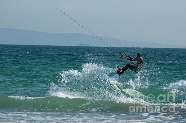 Kite Surfer Jumping Over A Wave Print by Sami Sarkis
