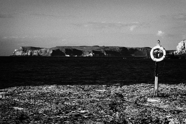 Lifebelt On Rocks At Ballintoy With Moyle Sea And Rathlin Island Print by Joe Fox