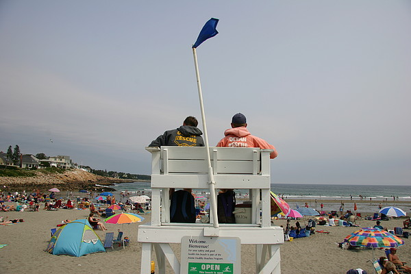 Lifeguards Watch Over The Traditional Print by Stephen St. John