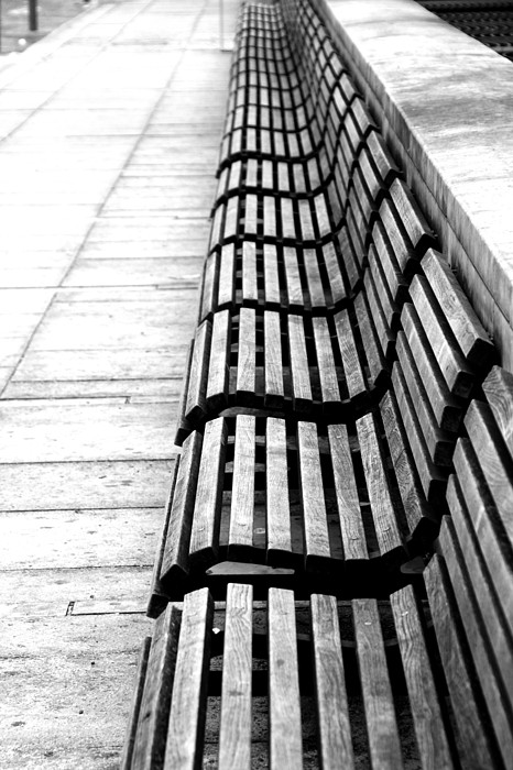Line Of Empty Benches Print by Christoph Hetzmannseder