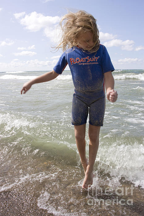 Little Girl Jumping In The Surf In Lake Michigan Print by Christopher Purcell