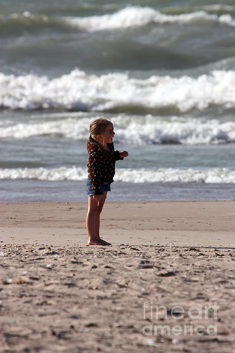 Little Girl Standing On Beach by - 55.8KB