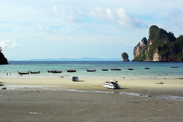 Long Tail Boats In Bay Of Phi Phi, Thailand Print by Thepurpledoor