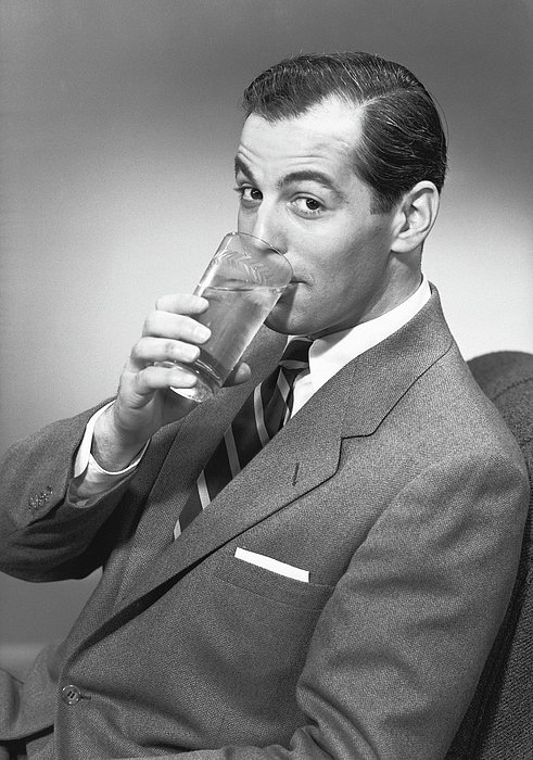 Man Drinking Water From Glass, Posing In Studio, (b&w), Portrait Print by George Marks