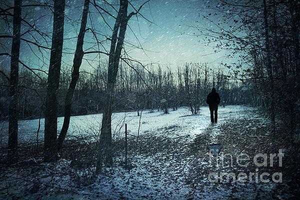 Man Walking In Snow At Winter Twilight Print by Sandra Cunningham