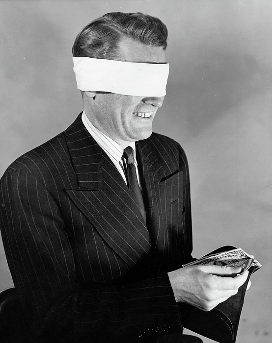Man Wearing Blindfold Holding Money (b&w) Print by Hulton Archive