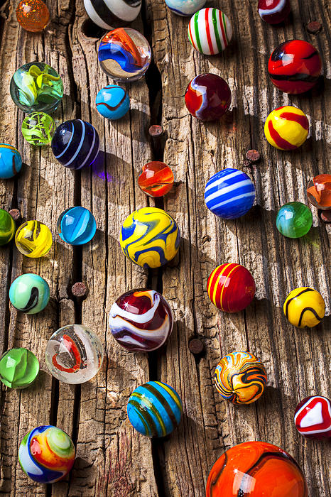 Marbles On Wooden Board Print by Garry Gay