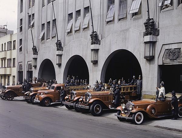 Men And Vehicles Of A Fire Department Print by Richard Hewitt Stewart